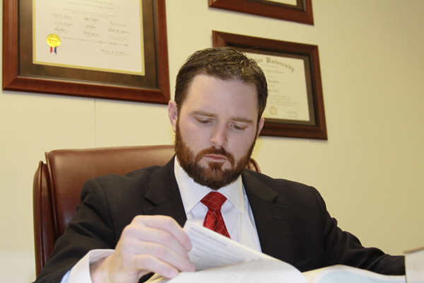 Attorney Cody L. Cofer preparing a case at his desk