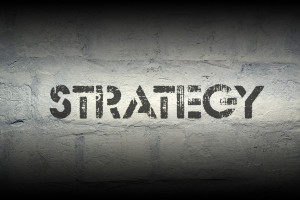 strategy stencil print on the grunge white brick wall