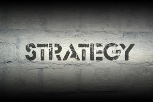 strategy stencil print on the grunge white brick wall