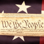Closeup of the United States Constitution on an American flag with retro filter and vignette applied. Perfect for USA patriotic holiday projects.